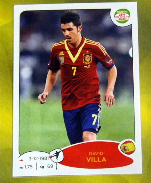 El vigente campeón del mundo se hace presente el el álbum con David Villa como figura (Cromo: Editorial Panini)