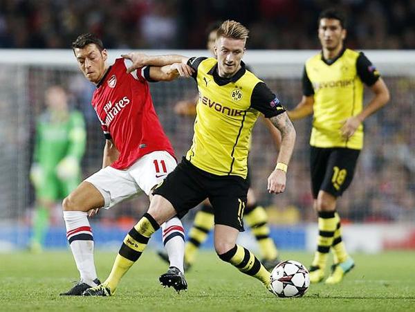 Arsenal y Dortmund se enfrentaron en la Champions 2013/14 (Foto: AFP)