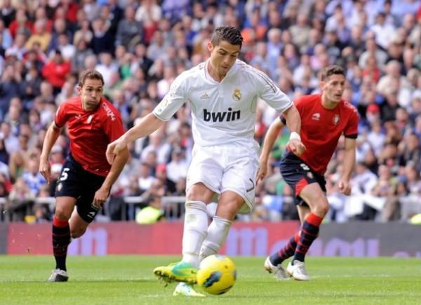 A SU ESTILO. De la mano de Cristiano Ronaldo, Real Madrir humilló a Osasuna y se mantiene en lo alto de la tabla de posiciones. (Foto: AP)