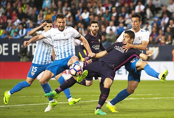 El Málaga ha logrado una estadística interesante sobre el Barcelona. (Foto: AP)