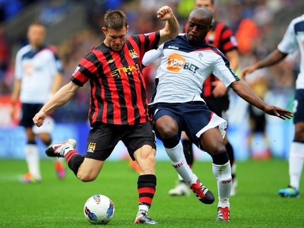 DA LA HORA. El volante de City, 'Choclo' Milner, fue uno de los estandartes para que su equipo se lleve la victoria ante Bolton. (Foto: AFP)